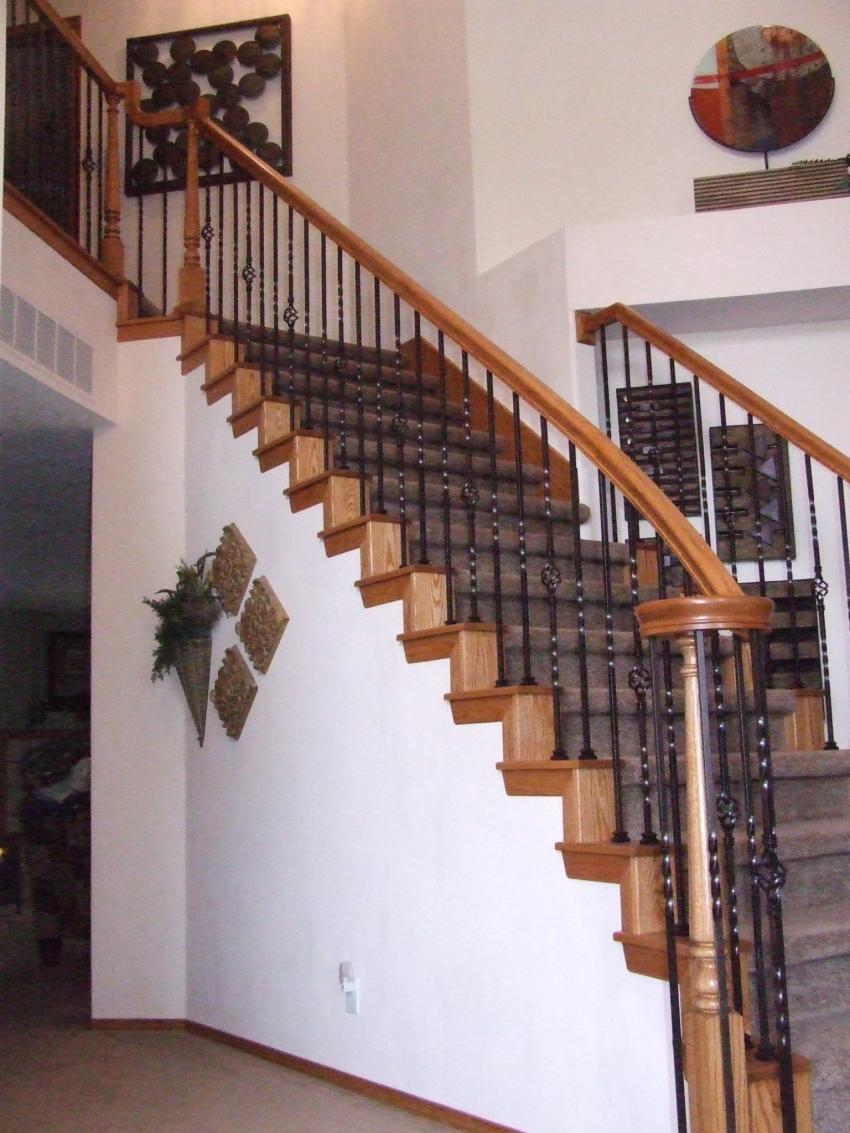 This Star Remodel Features Red Oak False Tread And Riser End Caps With  Simple Yet Elegant Oil Rubbed Bronze Iron Balusters.