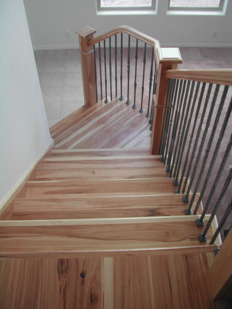 This Stairway Features Beautiful Hickory Treads And Risers, Stair Skirting,  Handrail, And Box Newels With Santa Fe Series Individual Iron Balustrade.