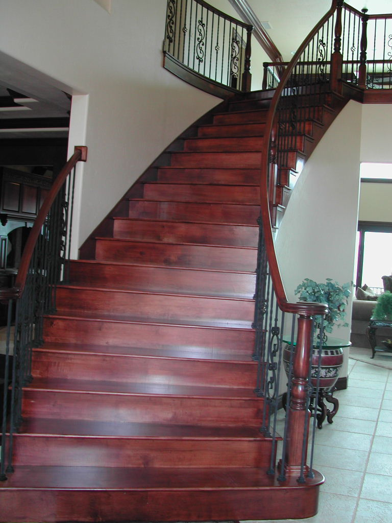 This Stair Features Maple Treads And Risers With Full Starter Step And  Volute At Entry. The Treads Have Mitered Returns On Open Side Of Stairway.