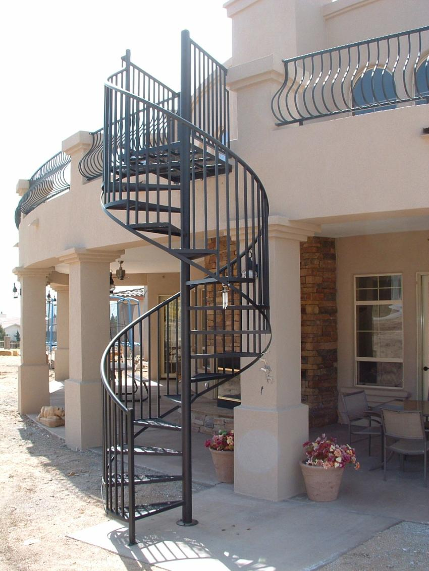 Standard Exterior Steel Spiral Stair With Expanded Metal Treads. Featuring  Belly Style Deck Railing With Hammered Top And Bottom Railing~Painted Black.