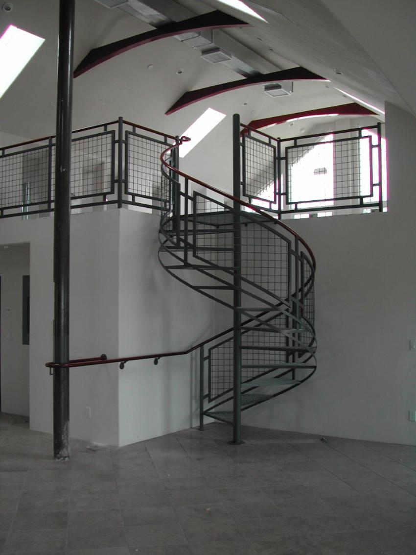 Contemporary Interior Steel Spiral Stair And Deck Railing With Wire Mesh  Infill. Two Tone Painted Finish.