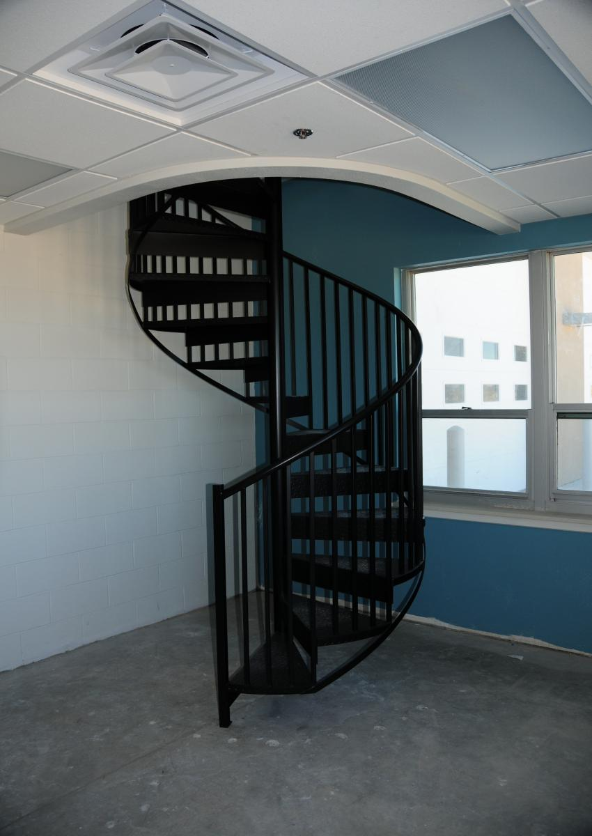 Fabricated For A Santa Fe Fire Station This Interior Steel Spiral Stair  Features Deck Plate Treads And Riser With Standard Guardrail~Painted Black.